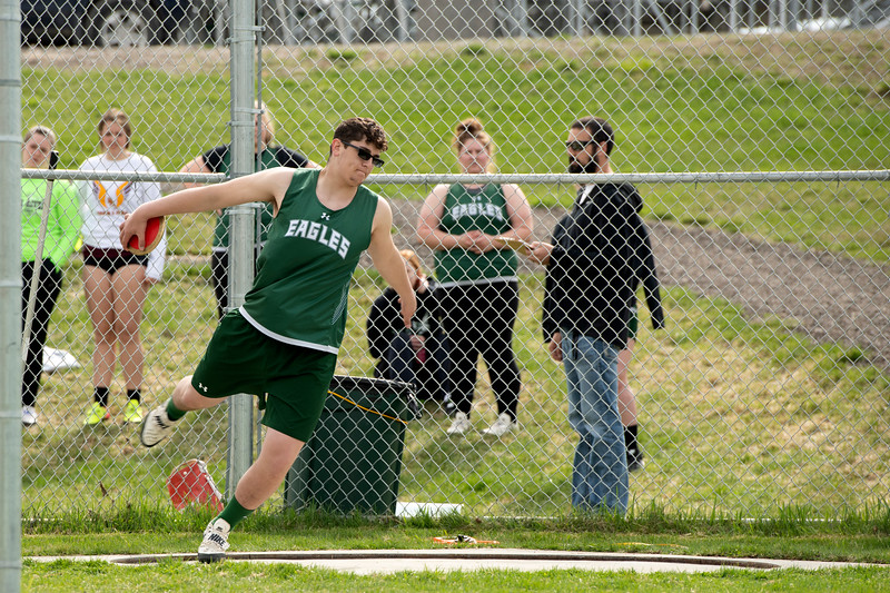 Matthew Gaston | The Sheridan Press<br>Tongue River's Jacob Knobloch winds up for the discus Friday, April 26, 2019.