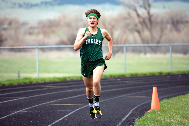Matthew Gaston | The Sheridan Press<br>Tongue River's Cooper Vollmer during the final lap of the 1600-meter run at Tongue River High School Friday, April 26, 2019.