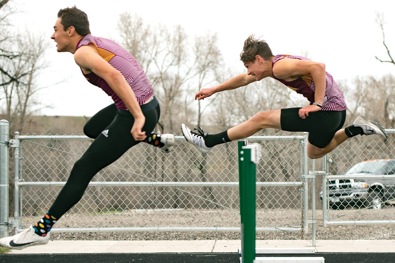 Matthew Gaston | The Sheridan Press<br>Big Horn's Kyler Ostler, left, and Liam Greenelsh battle it out during the 110-meter hurdles at the Tongue River High School meet Friday, April 26, 2019.