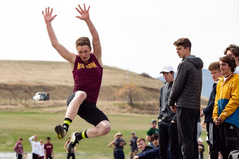 Matthew Gaston | The Sheridan Press<br>Big Horn's Luke Mullinax competes in the long jump Friday, April 26, 2019.