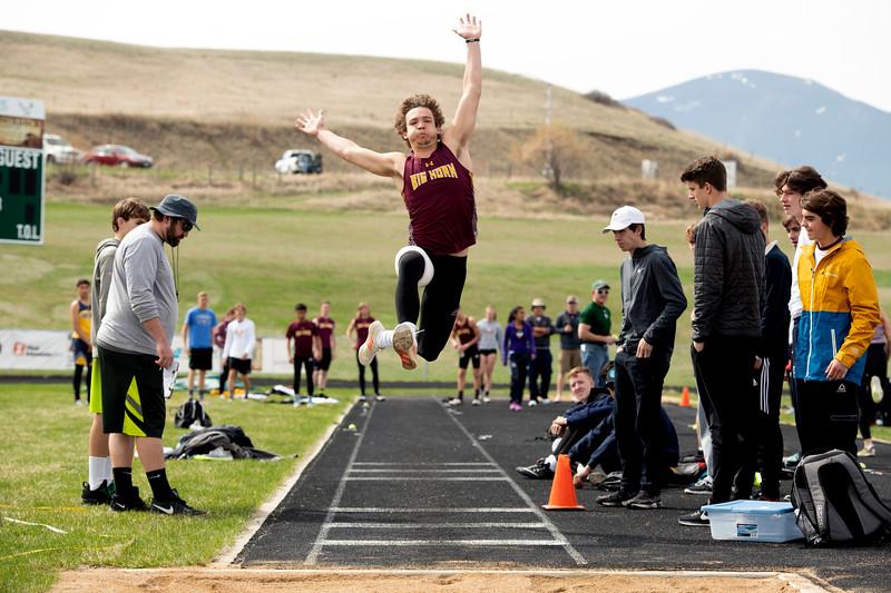 Matthew Gaston | The Sheridan Press<br>Big Horn's Kade Eisele takes flight during the long jump at Tongue River High School Friday, April 26, 2019.