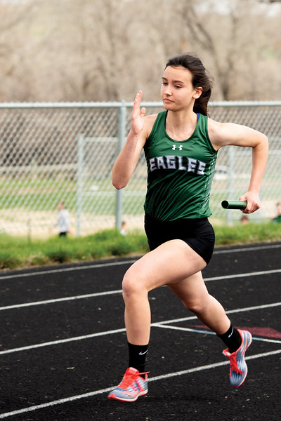 Matthew Gaston | The Sheridan Press<br>Tongue River's Izzy Carbert takes the lead during the 1600-meter relay Friday, April 26, 2019.