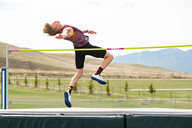 Matthew Gaston | The Sheridan Press<br>Big Horn's Kade VanDyken soars over the bar, at 5 feet 8 inches, with ease Friday, April 26, 2019.