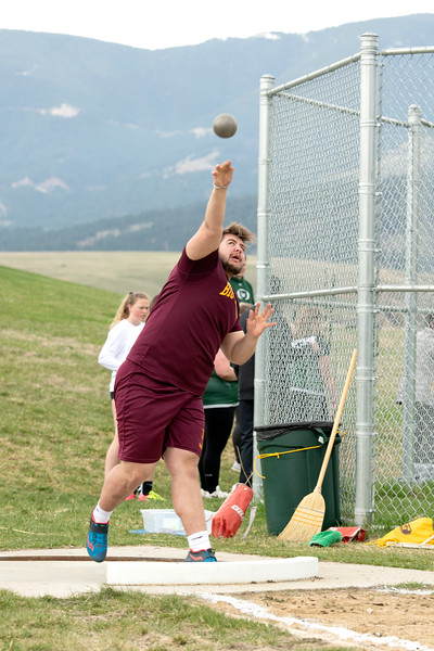 Matthew Gaston | The Sheridan Press<br>Big Horn's Jaxon Parker heaves the shot put into the air during the track meet at Tongue River High School Friday, April 26, 2019.