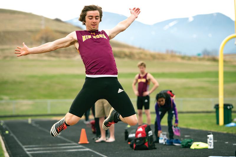 Matthew Gaston | The Sheridan Press<br>Big Horn's Carson Bates flies high during the triple jump Friday, April 26, 2019.