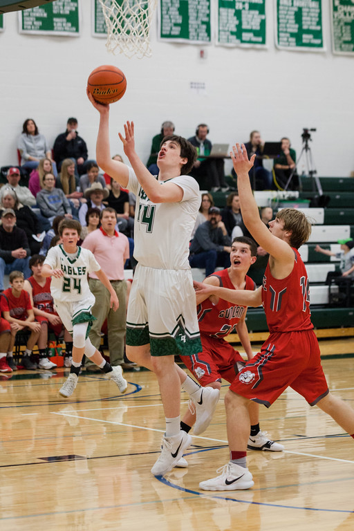 Tibby McDowell | The Sheridan Press<br /> <br /> Hugh Patterson scores two on a layup against Sundance at Tongue River High School Saturday Jan. 27, 2018.