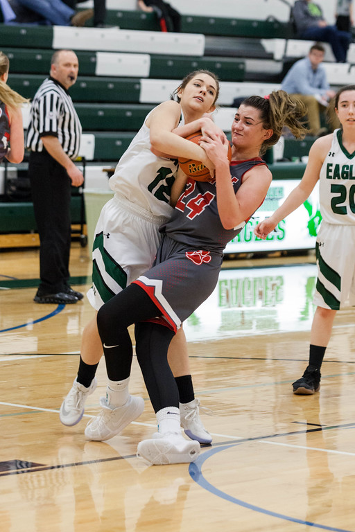 Tibby McDowell | The Sheridan Press<br /> <br /> Eagles player Sarah Summers, left, and Rigan McInerney, right from Sundance, fight for the ball at Tongue River High School Saturday Jan. 27, 2018.