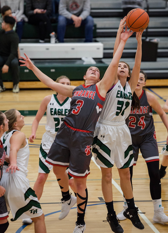 Tibby McDowell | The Sheridan Press<br /> <br /> Holly Hutchinson, right, went up against Madison Gill from Sundance, left, for the rebound at Tongue River High School Saturday Jan. 27, 2018.