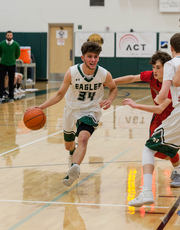 Tibby McDowell | The Sheridan Press<br /> <br /> Jaren Fritz drives his way to the basket against Sundance at Tongue River High School Saturday Jan. 27, 2018.