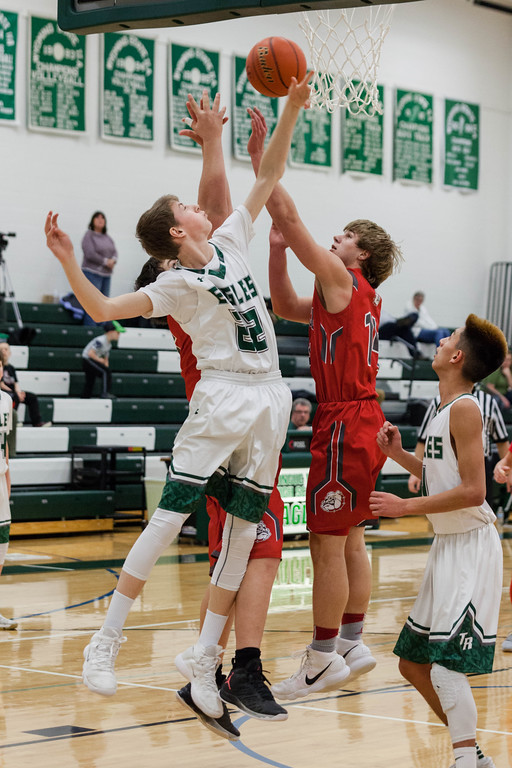 Tibby McDowell | The Sheridan Press<br /> <br /> Justice Rees goes up for the rebound against Sundance at Tongue River High School Saturday Jan. 27, 2018.
