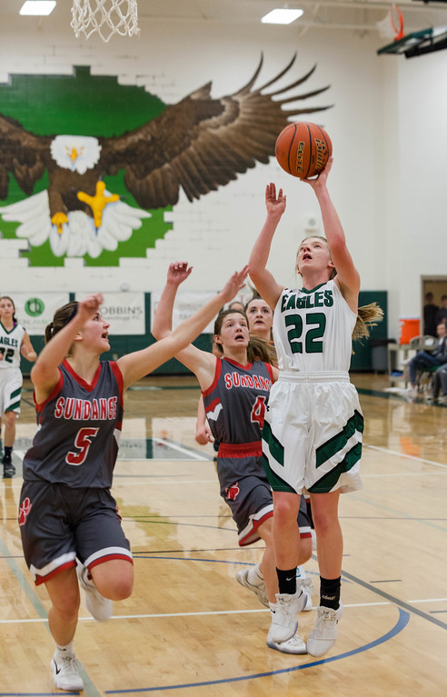 Tibby McDowell | The Sheridan Press<br /> <br /> Kalie Bocek scores two for the Eagles against Sundance at Tongue River High School Saturday Jan. 27, 2018.