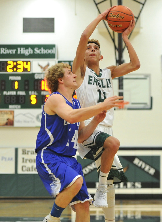 Justin Sheely | The Sheridan Press<br /> <br /> Tongue River's Jay Keo shoots over Upton's Dawson Butts at Tongue River High School Friday, Feb. 2, 2018. The Eagles were shot down 83-65.