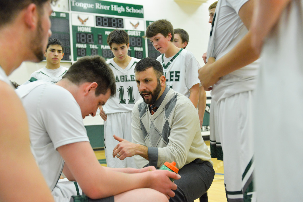 Justin Sheely | The Sheridan Press<br /> <br /> Tongue head coach Ronnie Stewart talks to the boys during a timeout against Upton at Tongue River High School Friday, Feb. 2, 2018. The Eagles were shot down 83-65.
