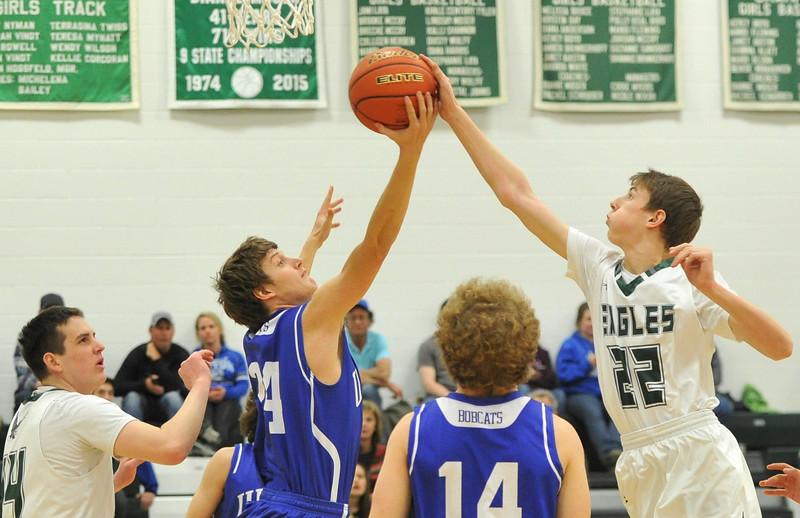 Justin Sheely | The Sheridan Press<br /> <br /> Tongue River's Justice Reece, right, tries to rebound against Upton's Payton Watt at Tongue River High School Friday, Feb. 2, 2018. The Eagles were shot down 83-65.