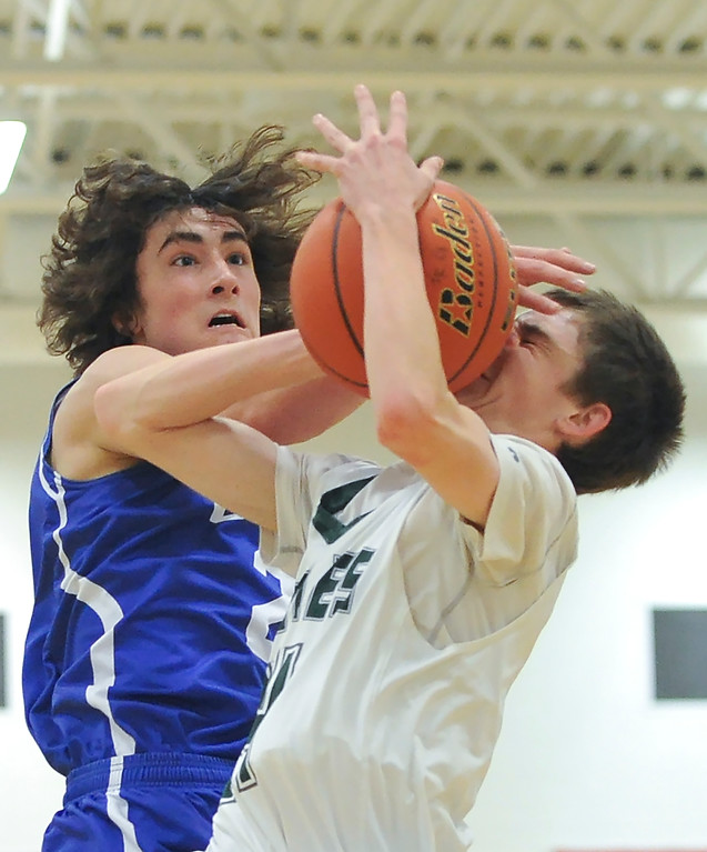 Justin Sheely | The Sheridan Press<br /> <br /> Tongue River's Nick Summers, right, is fouled by Upton's Clayton Louderback at Tongue River High School Friday, Feb. 2, 2018. The Eagles were shot down 83-65.