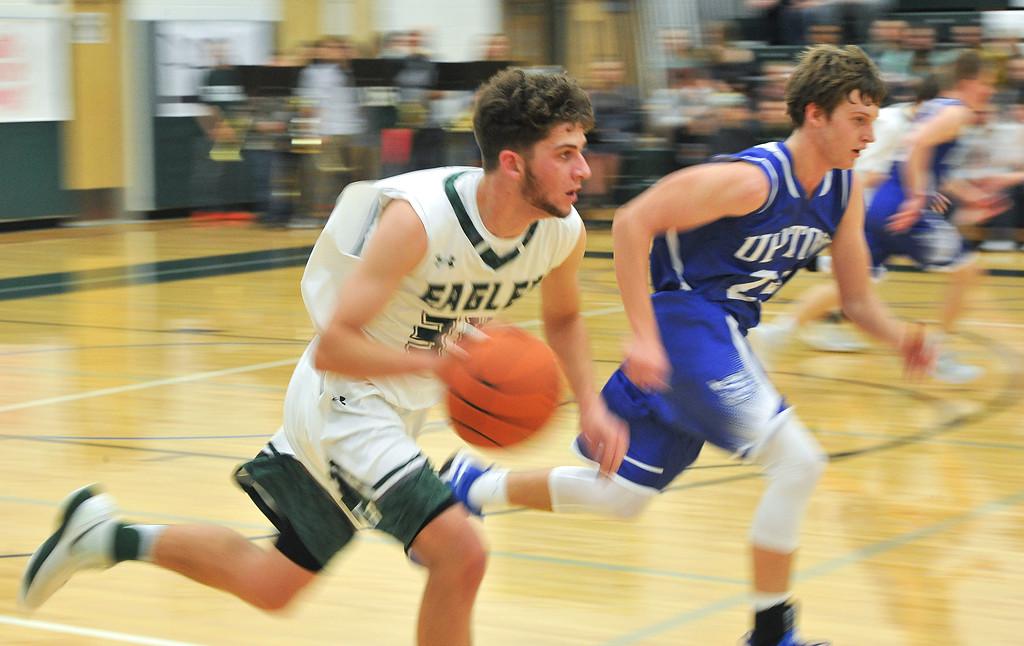 Justin Sheely | The Sheridan Press<br /> <br /> Tongue River's Jaren Fritz drives the ball against Payton Watt at Tongue River High School Friday, Feb. 2, 2018. The Eagles were shot down 83-65.