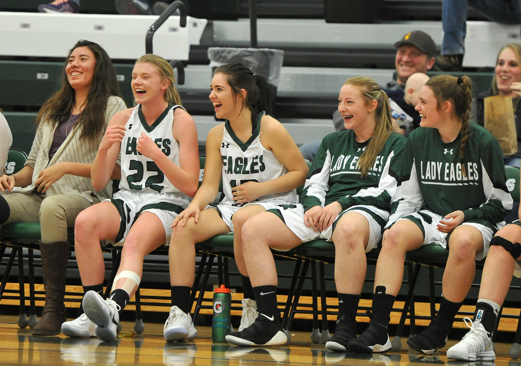 Justin Sheely | The Sheridan Press<br /> <br /> The Lady Eagles from the bench react as head coach Tyler Hanson knocks down a ball stuck on the rim during the game against Upton at Tongue River High School Friday, Feb. 2, 2018. The Lady Eagles won 59-24.