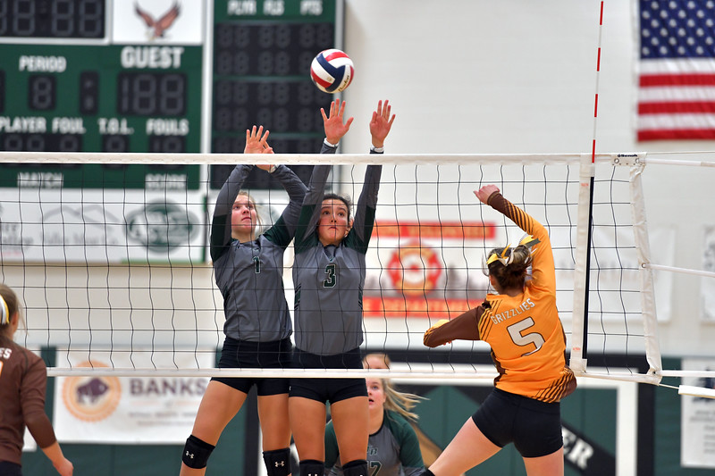 Matthew Gaston | The Sheridan Press<br>Tongue River's Carleigh Reish (1) and Izzy Carbert (3) elevate for the block against Rocky Mountain's Alexis Minemyer (5) Friday, Sept. 27, 2019.