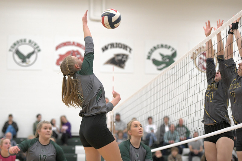 Matthew Gaston | The Sheridan Press<br>Tongue River's Jane Pendergast (4) spikes the ball across the court to avoid Greybulls blockers Friday, Oct. 18, 2019.