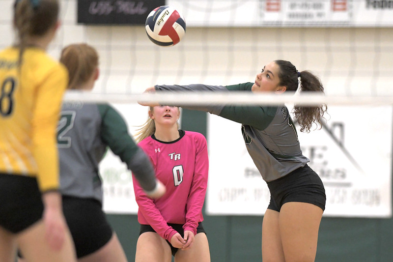 Matthew Gaston | The Sheridan Press<br>Tongue River's Raessa Williams (10) comes up with dig against Wright Friday, Oct. 25, 2019.