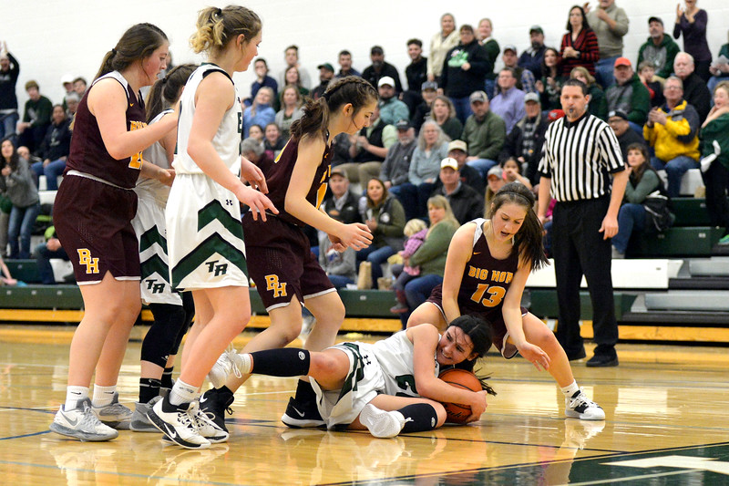 Joel Moline   The Sheridan Press<br /> Tongue River's Izzy Carbert (20) falls to the ground after rebounding the ball, resulting in a traveling violation during the game between Tongue River and Big Horn high schools Thursday, Feb. 6, 2020.