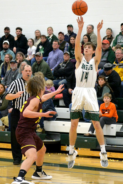 Joel Moline   The Sheridan Press<br /> Tongue River's Nick Summers (14) attempts a 3-pointer against Big Horn, Thursday, Feb. 6, 2019.