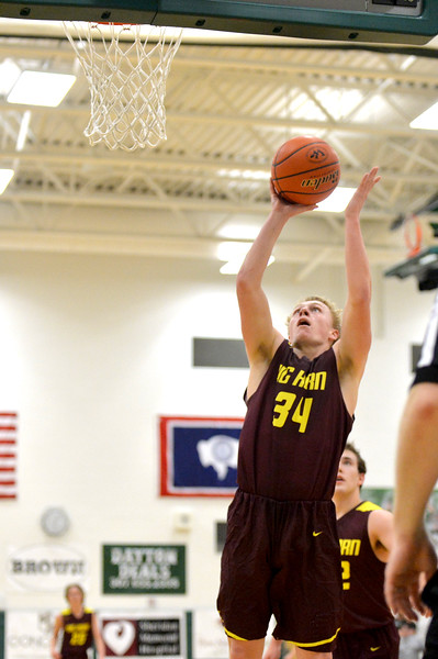Joel Moline   The Sheridan Press<br /> Big Horn's Quinn McCafferty (34) scores a layup during the game between Tongue River and Big Horn high schools Thursday, Feb. 6, 2020.