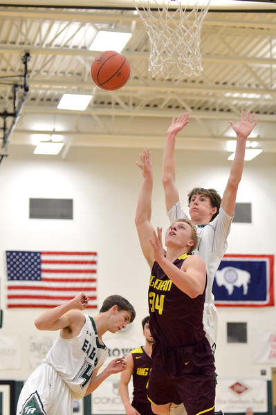 Joel Moline   The Sheridan Press<br /> Big Horn's Quinn McCafferty (34) draws the and-one after a pump fake makes the defense jump during the game between Tongue River and Big Horn high schools Thursday, Feb. 6, 2020.
