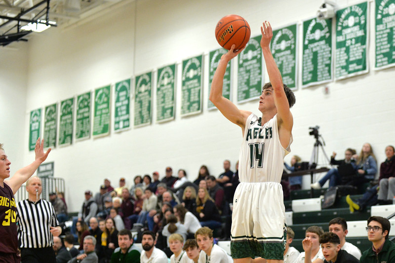 Joel Moline   The Sheridan Press<br /> Tongue River's Nick Summers (14) makes a 3-pointer, cutting the Big Horn lead to three points during the fourth quarter of the game between Tongue River and Big Horn high schools Thursday, Feb. 6, 2020.