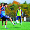 New England Revolution's Diego Fagundez, 18, of Leominster (near) traps the ball during a drill as teammates (back from left) Juan Agudelo, Lee Nguyen, and Kelyn Rowe look on during an October 2013 practice at Gillette Stadium in Foxboro. SENTINEL & ENTERPRISE / BRETT CRAWFORD<br /> SENTINEL & ENTERPRISE / BRETT CRAWFORD