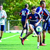 New England Revolution's Diego Fagundez, 18, of Leominster (right) passes the ball as Head Coach Jay Heaps (left) looks on during a drill during an October 2013 practice at Gillette Stadium in Foxboro. SENTINEL & ENTERPRISE / BRETT CRAWFORD