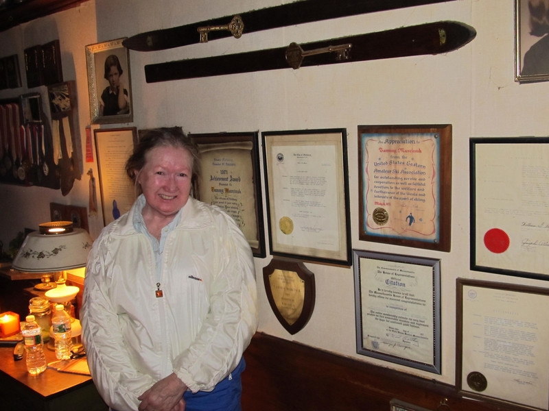 "Tamara ""Tammy"" Marcinuk poses in her Kimball Street home next to two keys to the city of Fitchburg. Marcinuk enjoyed a stellar skiing career, winning numerous hearing and non-hearing competitions, including five Deaflympic Games gold medals. 		SENTINEL & ENTERPRISE / NICK MALLARD"