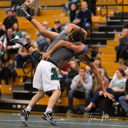 Wrestling is a fairly easy sport to shoot. Also, you can get a lot of cool images. Something about a body getting airborne always makes for a good shot IMHO.