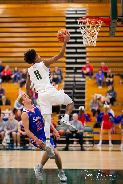 I have about 1,000 of Isaiah making plays on the basketball court and it is never fair to pick only one. Let's just call this a representative shot of him making a play.