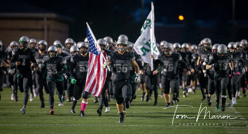 One of my favorites of the 2019 Senior class Evan leading the team on to the field.