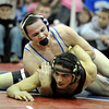 "Broomfield High School's Phil Downing tries to flip over Alamosa High School's Pablo Ortiz  in the 138-pound class during the Top of the Rockies wrestling tournament on Saturday, Jan. 21, at Centaurus High School. Downing won the match to take 1st place in the tournament. For more photos of the tournament go to  <a href=""http://www.dailycamera.com"">http://www.dailycamera.com</a><br /> Jeremy Papasso/ Camera"