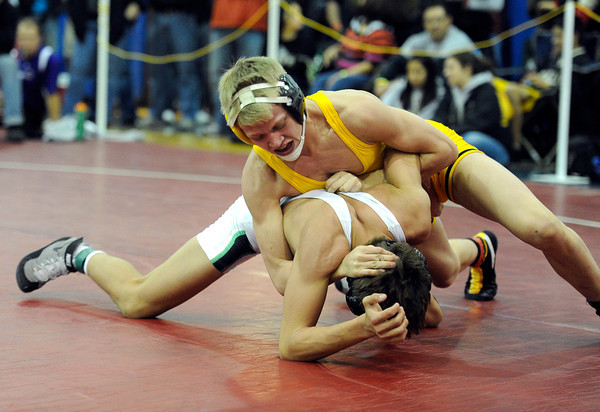 """Thompson Valley High School's Tanner Williams goes for a half nelson while wrestling Palo Verde High School's Jordan Hart in the 120-pound class during the Top of the Rockies wrestling tournament on Saturday, Jan. 21, at Centaurus High School. Williams lost the match. For more photos of the tournament go to  <a href=""""http://www.dailycamera.com"""">http://www.dailycamera.com</a><br /> Jeremy Papasso/ Camera"""