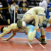 "Broomfield High School's Jonathon Stelling tries for a take-down while wrestling Greeley West's Emilio Martinez during the Top of the Rockies wrestling tournament on Saturday, Jan. 21, at Centaurus High School. Stelling lost the match. For more photos of the tournament go to  <a href=""http://www.dailycamera.com"">http://www.dailycamera.com</a><br /> Jeremy Papasso/ Camera"
