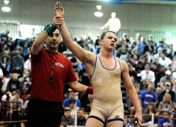 """The referee holds up the hand of Broomfield High School's Phil Downing after he defeated Alamosa High School's Pablo Ortiz  in the 138-pound class during the Top of the Rockies wrestling tournament on Saturday, Jan. 21, at Centaurus High School. For more photos of the tournament go to  <a href=""""http://www.dailycamera.com"""">http://www.dailycamera.com</a><br /> Jeremy Papasso/ Camera"""