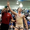 "The referee holds up the hand of Broomfield High School's Phil Downing after he defeated Alamosa High School's Pablo Ortiz  in the 138-pound class during the Top of the Rockies wrestling tournament on Saturday, Jan. 21, at Centaurus High School. For more photos of the tournament go to  <a href=""http://www.dailycamera.com"">http://www.dailycamera.com</a><br /> Jeremy Papasso/ Camera"