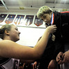 """Loveland High School's Jordan Henrickson bends down to recieve the 1st place medal from Centaurus High School cheerleader Mckenzie Miller after Henrickson defeated Grand Junction Central's Anthony Feller in the 145-pound class during the Top of the Rockies wrestling tournament on Saturday, Jan. 21, at Centaurus High School. For more photos of the tournament go to  <a href=""""http://www.dailycamera.com"""">http://www.dailycamera.com</a><br /> Jeremy Papasso/ Camera"""
