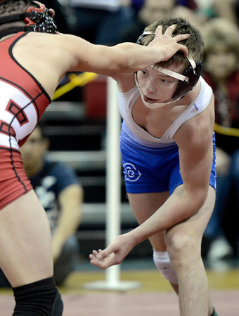 "Broomfield High School's Darek Huff ties up with Brighton High School's Tony Balderas in the 106-pound class during the Top of the Rockies wrestling tournament at Centaurus High School In Lafayette. Huff won the match. For more photos of the matches go to  <a href=""http://www.dailycamera.com"">http://www.dailycamera.com</a><br /> Jeremy Papasso/ Camera"