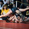 "Mead High School's Sage Budd tries for a pin while wrestling Valley High School's Ruben Lucero in the 113-pound class during the Top of the Rockies wrestling tournament at Centaurus High School In Lafayette. Budd lost the match. For more photos of the matches go to  <a href=""http://www.dailycamera.com"">http://www.dailycamera.com</a><br /> Jeremy Papasso/ Camera"