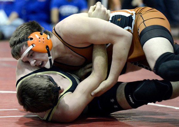 "Mead High School's Kyle Couch, top, works to pin Valley High School's Everett Collins in the 182-pound class during the Top of the Rockies wrestling tournament at Centaurus High School In Lafayette. Couch won the match. For more photos of the matches go to  <a href=""http://www.dailycamera.com"">http://www.dailycamera.com</a><br /> Jeremy Papasso/ Camera"