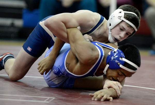 """Legacy High School's Ryan Deakin, top, works to flip Fort Lupton High School's Ferdinando Martinez during the Top of the Rockies wrestling tournament at Centaurus High School In Lafayette. Deakin won the match. For more photos of the matches go to  <a href=""""http://www.dailycamera.com"""">http://www.dailycamera.com</a><br /> Jeremy Papasso/ Camera"""
