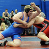 Austin Scheufele, left, of Centaurus lost to Gage Boyd of Pomona by a pin in the first period at Heavyweight.<br /> Cliff Grassmick / January 23, 2010