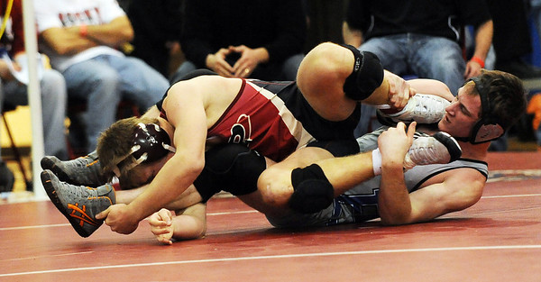 Josh Van Tine, right, of Broomfield, lost to Austin Gabel of Ponderosa in the finals of 171 pounds.<br /> Cliff Grassmick / January 23, 2010
