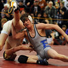 Courtland Hacker of Broomfield, right, works Andrew Riedy of Grand Island, NE, into a pin at 119 pounds on  Saturday.<br /> Cliff Grassmick / January 23, 2010