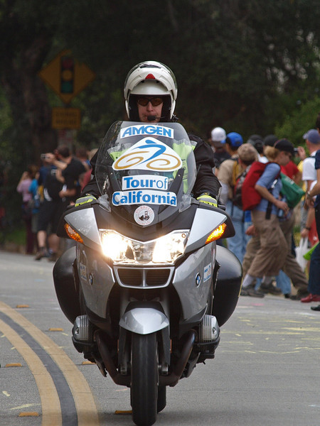 """Lead escort in the Amgen Tour de California bicycle races here in Pasadena on Saturday, February 21, 2009.<br />  <a href=""""http://www.amgentourofcalifornia.com"""">http://www.amgentourofcalifornia.com</a> <br /> The pack rode almost 90 miles in 3&1/2 hours. They climbed to about 4800 feet and 3600 feet at two different summits on Angeles Crest Highway, dropped 2800 feet downhill in 15 miles to the Rose Bowl and then circled for 25 miles up and downhill in this crowd."""