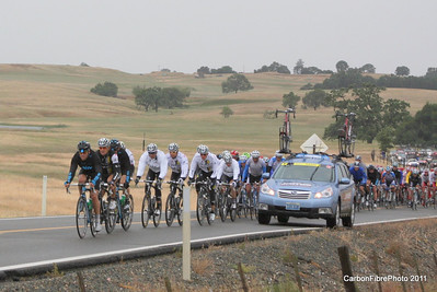 Stage 3, Car coming through Peloton, Pony Brown Road.